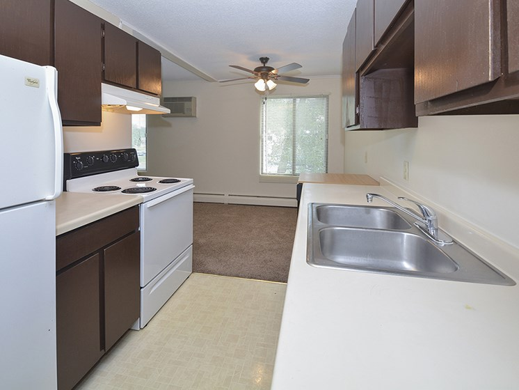 Kitchen with White Appliances and Dual Stainless Steel Kitchen Sink
