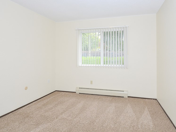 Bedroom with Large Double Window and Plush Carpeting