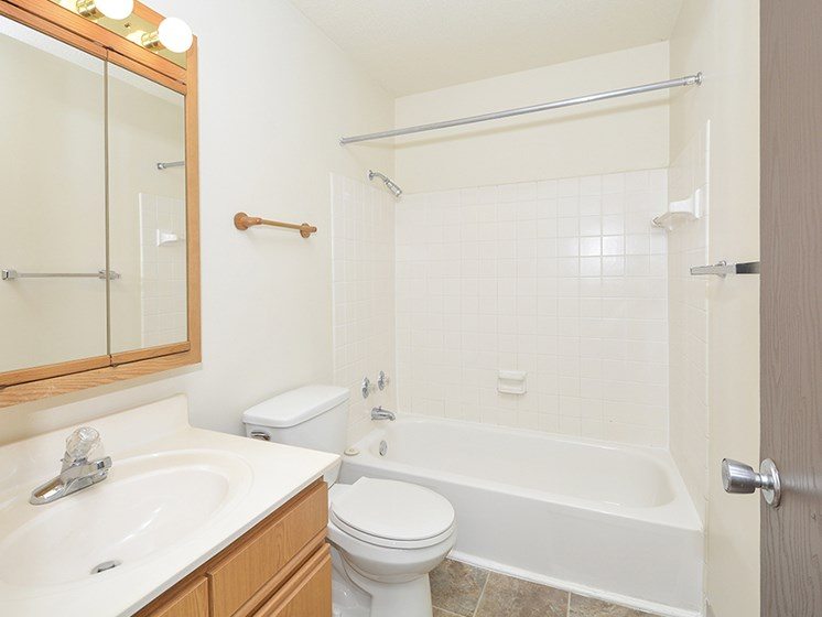 Full Sized Bathroom with Tile Style Flooring and Shower with Tub