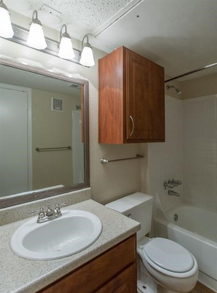 Canyon Ridge Apartments Rockwall, TX Bathroom with Framed Vanity Mirror