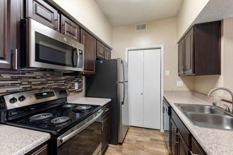 Fully Equipped Kitchen with Tile Backsplash