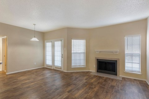 Living Room with Hardwood Style Floors and Fireplace