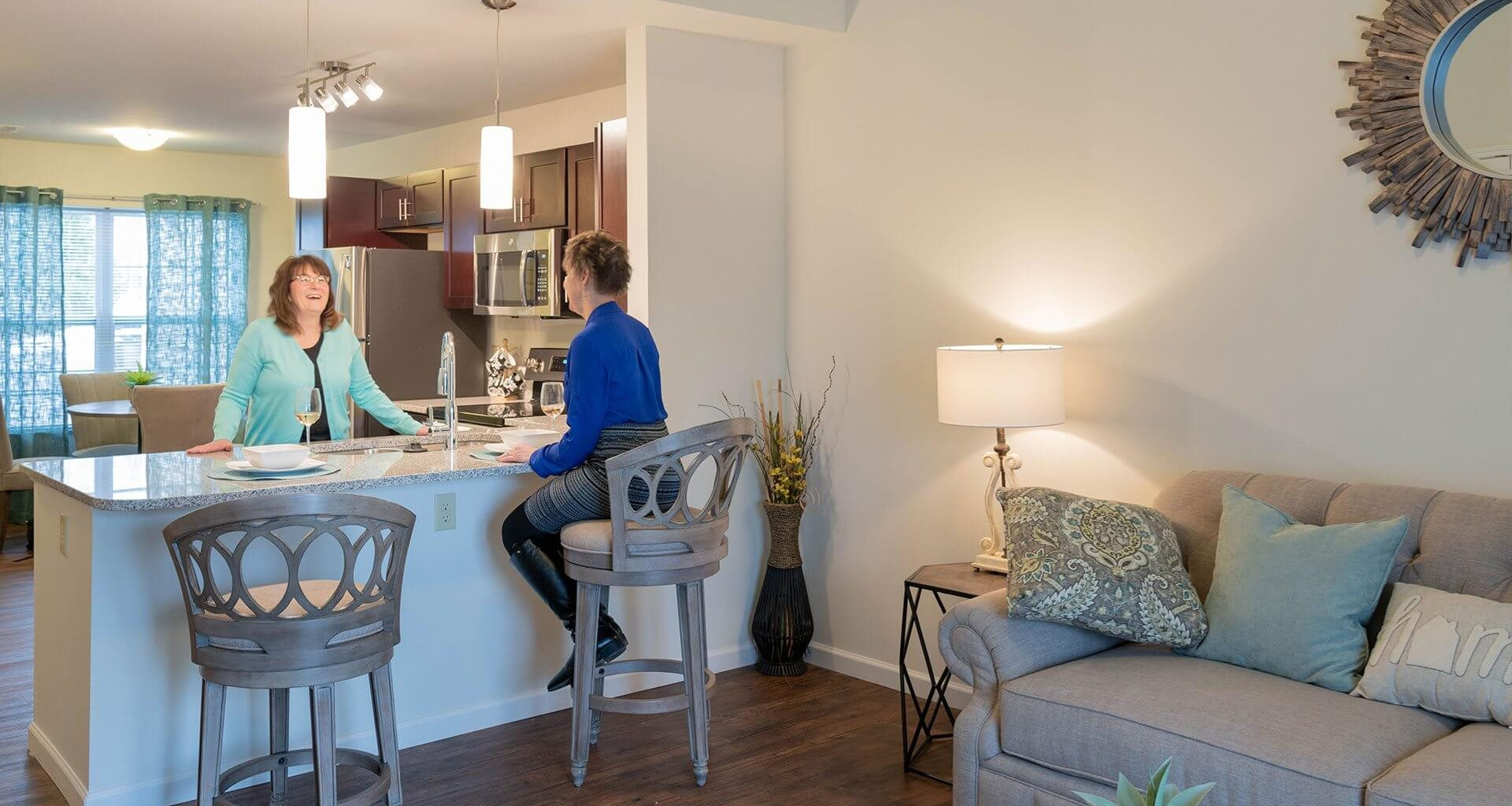 Kitchen With Breakfast Bar at Deerfield Place Luxury Apartments, Utica, 13502