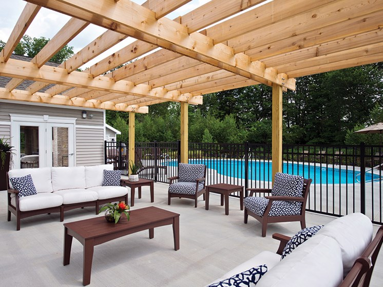Outdoor Pool And BBQ Area at Deerfield Place Luxury Apartments, Utica, NY