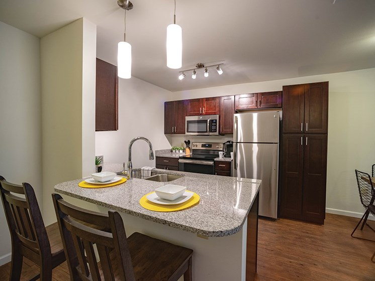 Eat-In Kitchen With Pendent Lights at Deerfield Place Luxury Apartments, New York