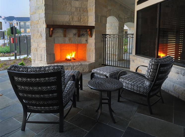 Outdoor Seating Area with Cozy Fire Pit at Landing at Round Rock, Round Rock, TX