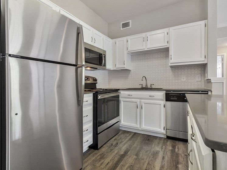 Apartments for Rent in Plano - Carrington Park Apartments Kitchen With Stainless Steel Appliances and Sleek White Cabinetry