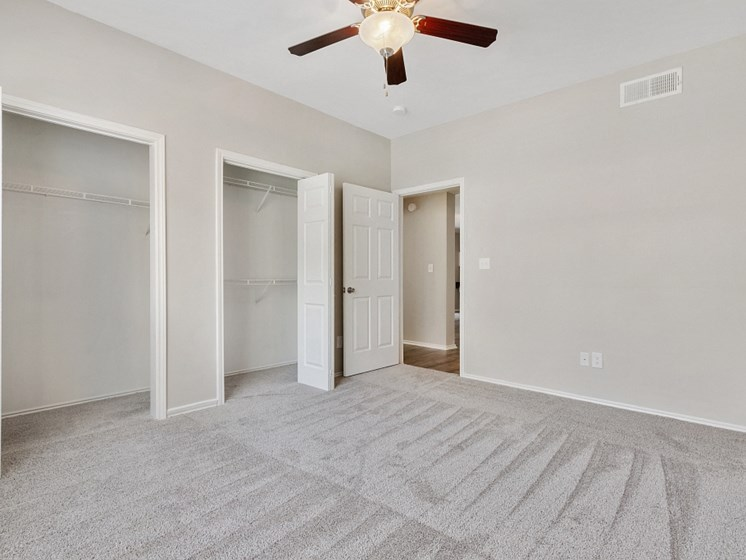 Luxury One Bedroom Apartments in Plano, TX - Carrington Park Apartments Bedroom With Ceiling Fan, Plush Carpeting and Large Closets