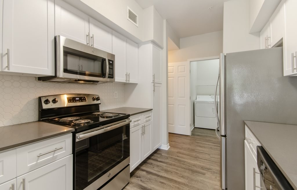New Home Upgrades: Gray Hand Scraped Wood Style Flooring, Quartz Countertops, Stainless Steel Energy Efficient Appliances, White Beehive Hexagon Back Splash, Brushed Nickel Hardware
