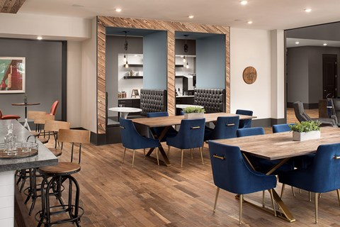 Super Modern Designed Clubhouse with Lounge Seating Areas, Community Study and Conference Room with Table and Seating for 8 at Bluebird Row Southside Apartments, Chattanooga, TN 37408