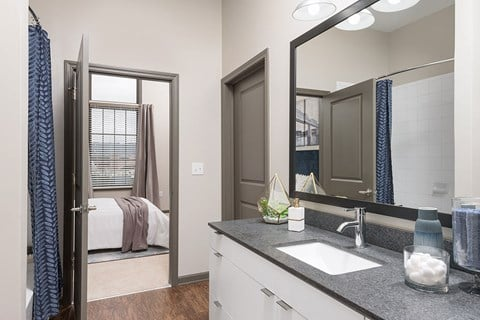 Relax after a long day in your bathroom with soaking tub, new cabinets, granite countertops at Bluebird Row Southside Apartments, Chattanooga, TN 37408