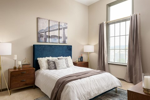 Master Bedroom Feels Large and Spacious with Impressive 9 Foot Ceilings and Large Walk-In Closets at Bluebird Row Southside Apartments, Chattanooga, TN 37408