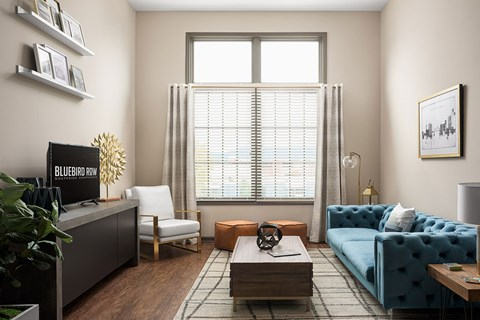 Wide Open Floorplan with Bar Area Seating, Pendant Lighting, Granite Countertops and Large Windows with Pool and Downtown Chattanooga Views at Bluebird Row Southside Apartments, Chattanooga, TN 37408
