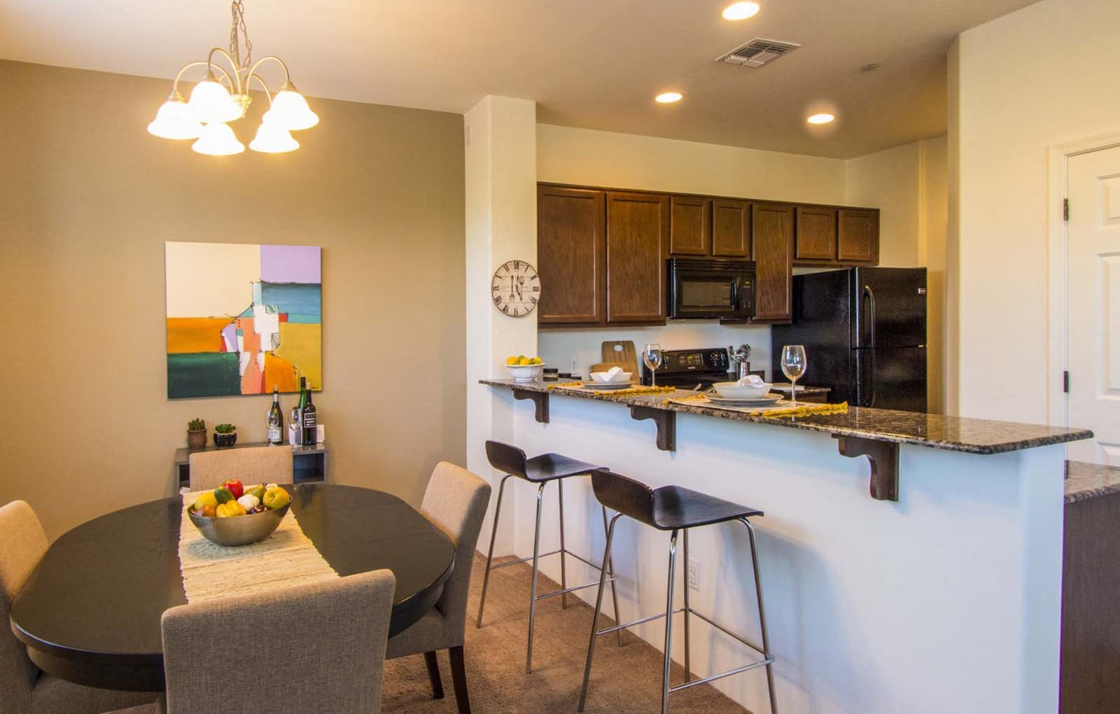 Dining area & breakfast bar at Galeria Del Rio Townhomes in Tucson, AZ