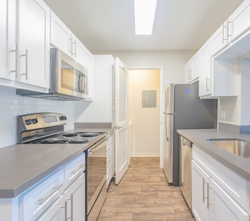 model kitchen with white cabinets and hardwood flooring