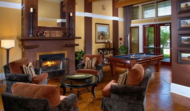 indoor lounge area with fireplace and pool table