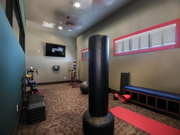 fitness area with yoga mat and punching bag