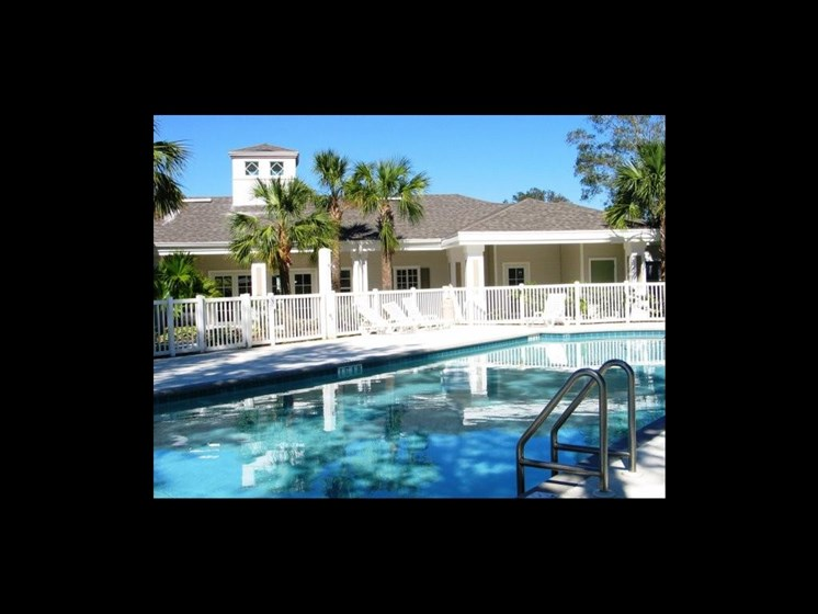 Outdoor pool with palm trees_The Crossings at Cape Coral Cape Coral, FL