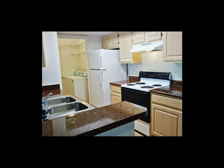 kitchen interior with stove and refrigerator_The Crossings at Cape Coral Cape Coral, FL