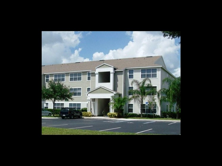 wide angle of building exterior with empty parking lot_The Crossings at Cape Coral Cape Coral, FL