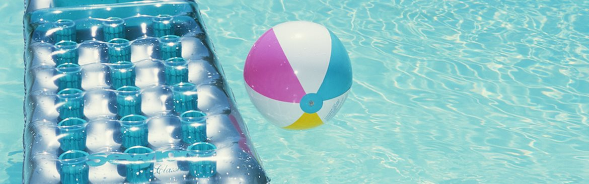 Floating pool bed and beach ball on outdoor pool_The Crossings at Cape Coral Cape Coral, FL