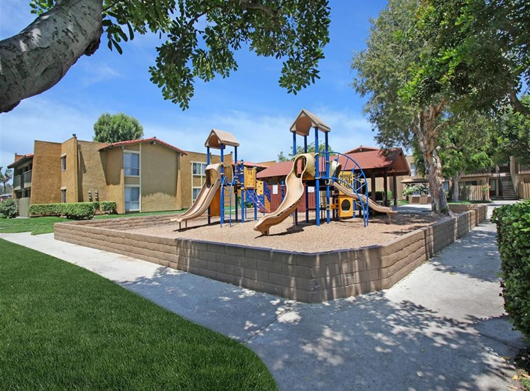 Community playground with slides at Casa Grande Apartment Homes