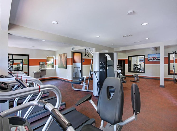 Gym showing weight machines and treadmills at Casa Grande Apartment Homes