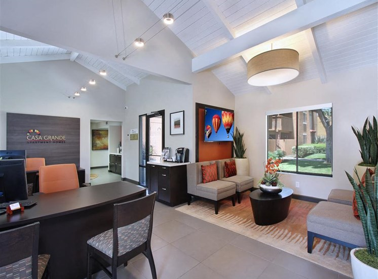 Casa Grande Apartments leasing office with inviting furnishings and vaulted ceilings