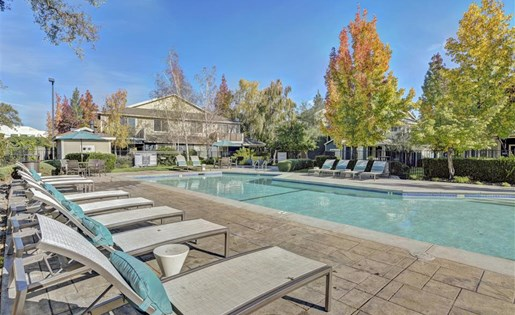 Poolside lounge chairs at Atwood Apartments in Citrus Heights CA