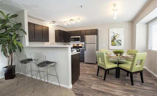 Renovated dining room and kitchen at Bella Vista Apartments in Elk Grove CA