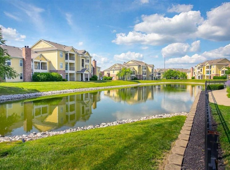 Beautiful lake in the center of the community with walking path at Center Point Apartments in Indianapolis, IN
