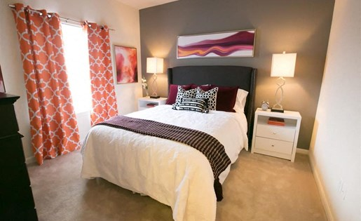 Bedroom with walk in closet at Center Point Apartments in Indianapolis, IN