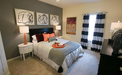 Bedroom with built-in desk at Center Point Apartments in Indianapolis, IN
