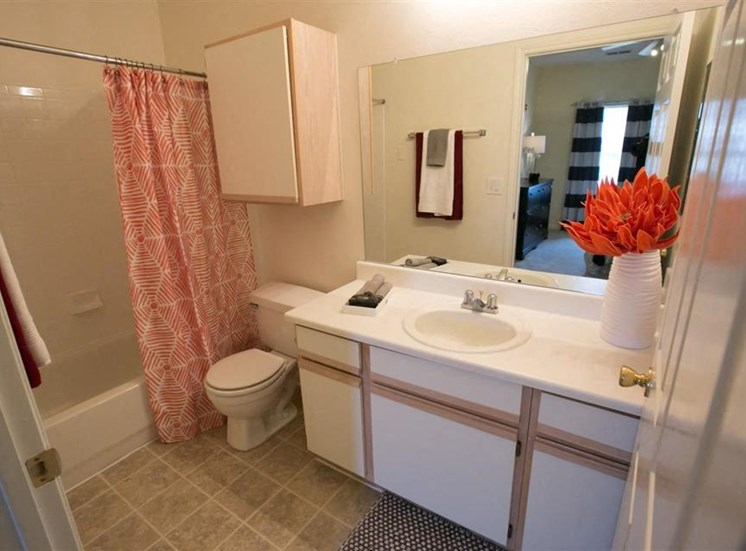 Bathroom with wall linen cabinet at Center Point Apartments in Indianapolis, IN