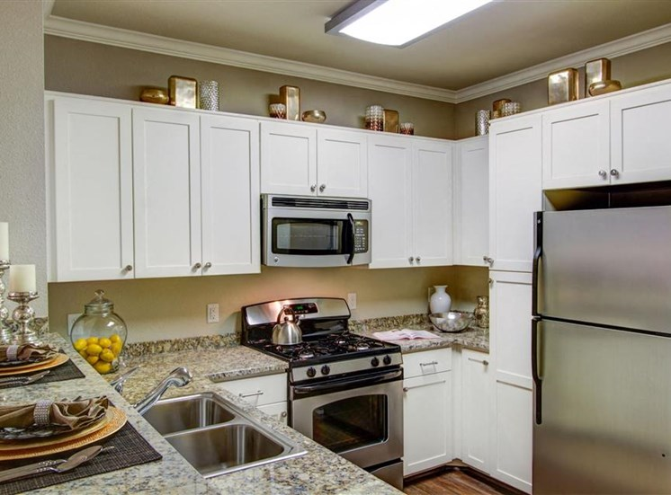 Antique white cabinets at Cerano Apartments in Milpitas CA
