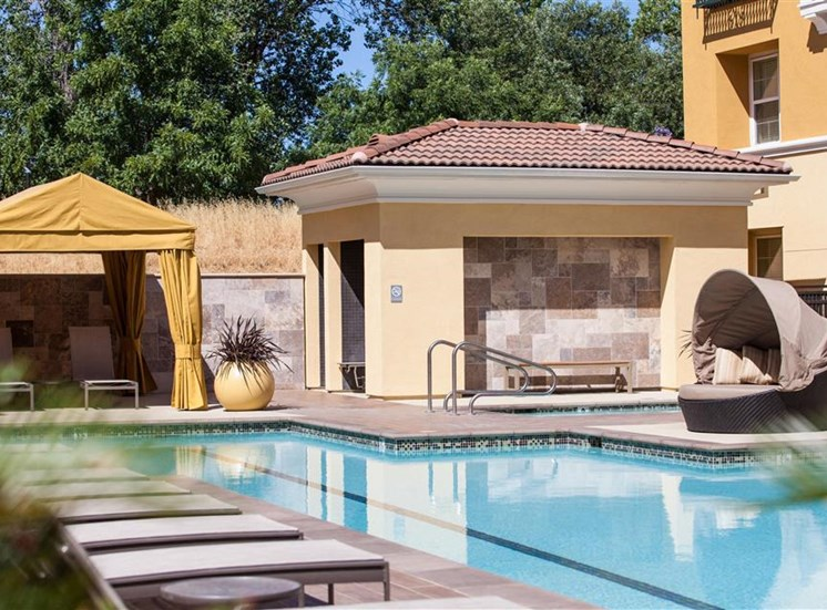 Cabanas and lounge chairs at Cerano Apartments in Milpitas CA