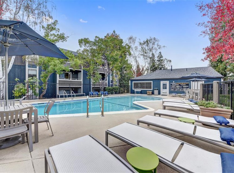 Pool lounge chairs at Hidden Creek Apartments in Martinez CA