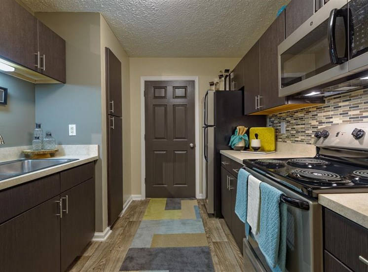 Galley kitchen at The Prato at Midtown Apartments in Atlanta, GA