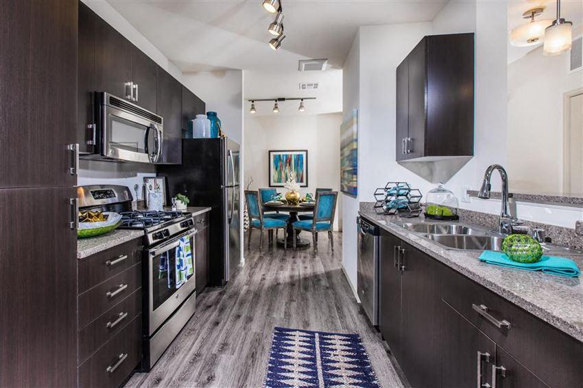 Kitchen in dark finish at Venue Apartments in San Jose CA