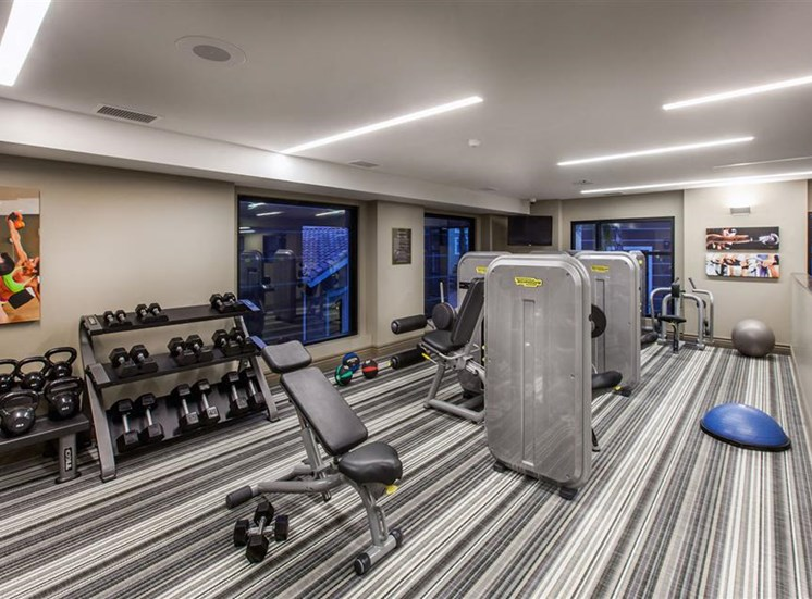 The Verdant Apartments fitness center with free weights in San Jose, CA
