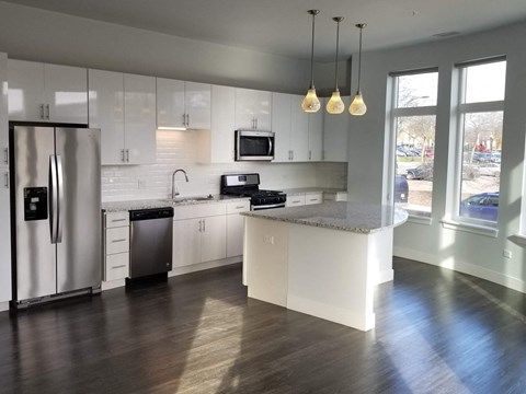 The kitchen of a DeLuxe Apartment at Burlington Station Luxury Residences