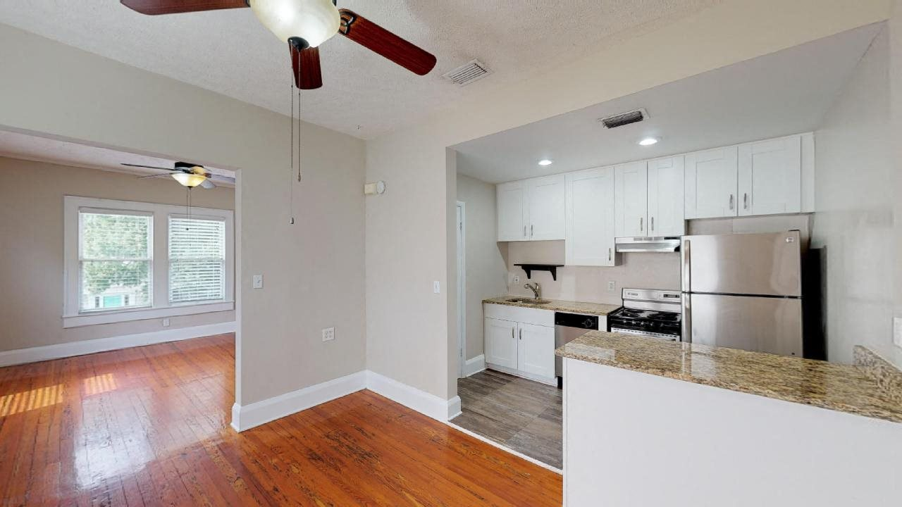 Open kitchen with stainless steel appliances and granite countertops