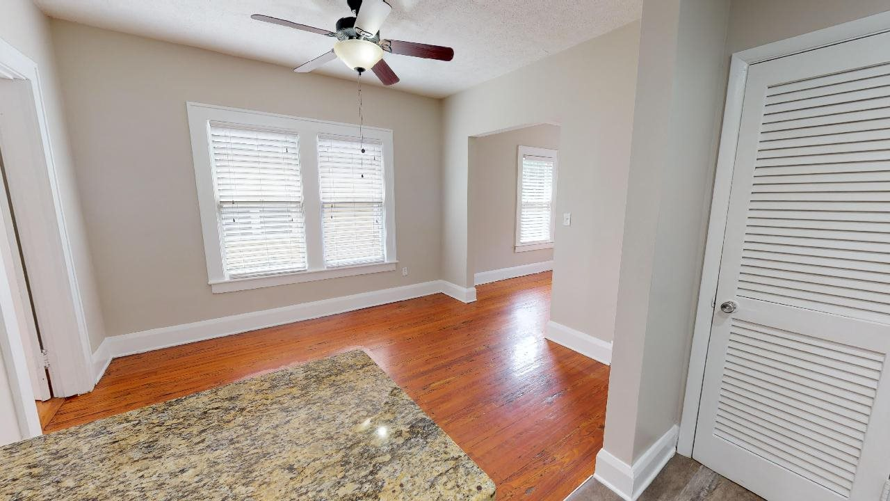 Open living area with ceiling fan and gorgeous hardwood flooring