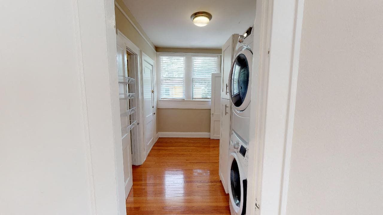 Large laundry room with washer and dryer and plenty of extra storage