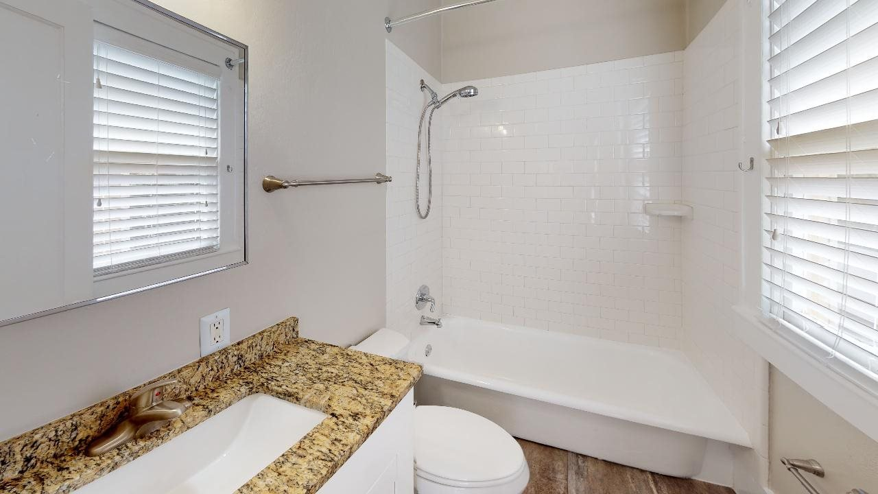 Nicely renovated bathroom with granite countertops