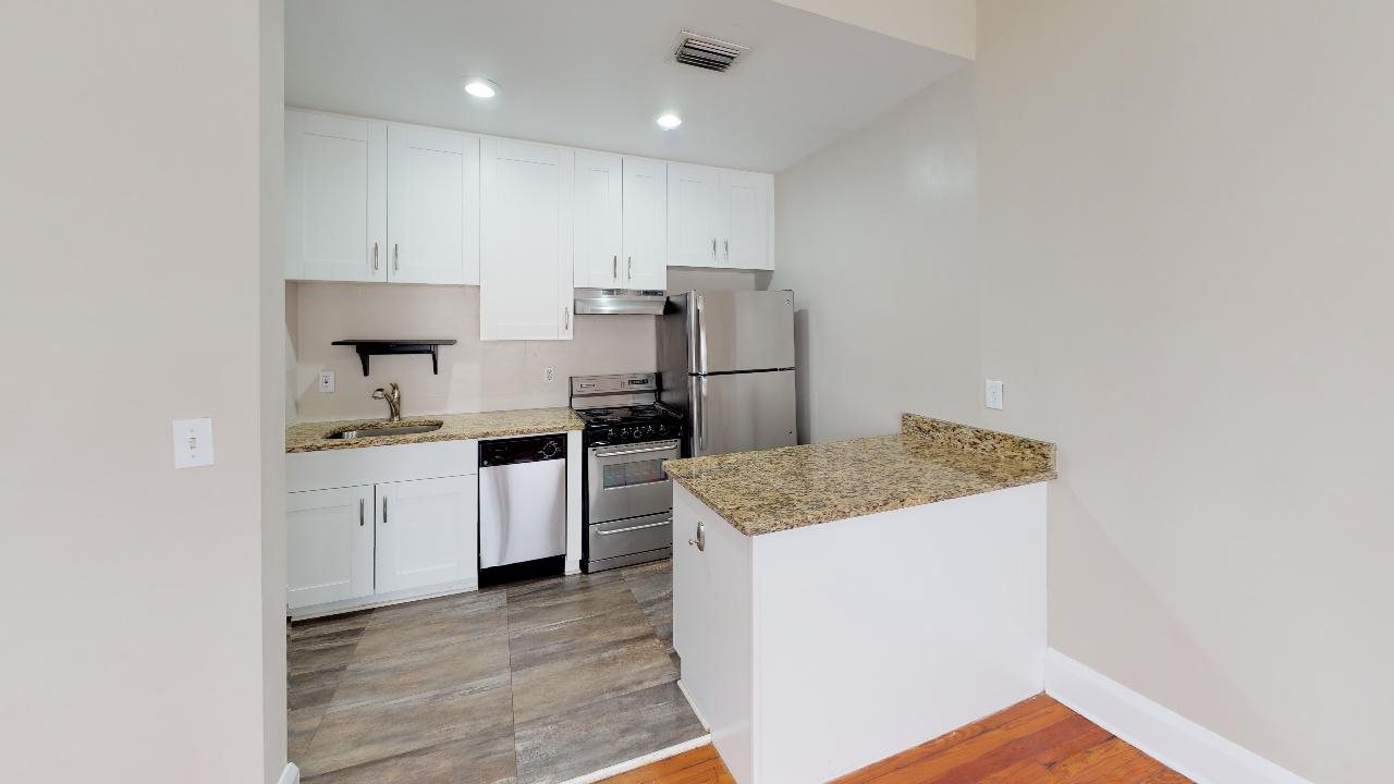 Large kitchen island open to the spacious living area.
