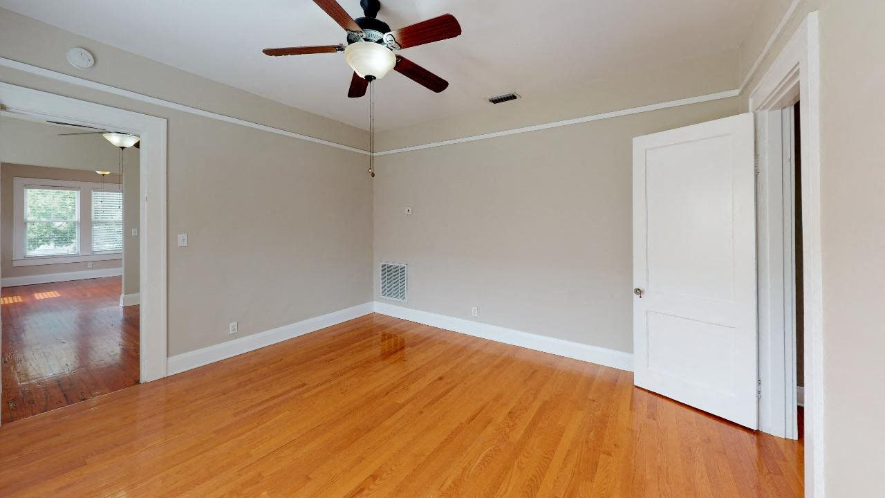 Large bedroom with private bathroom and a ceiling fan