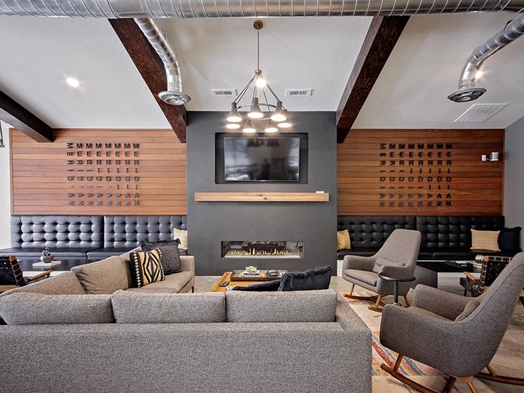 Cluhouse lounge seating, fireplace and wall tv