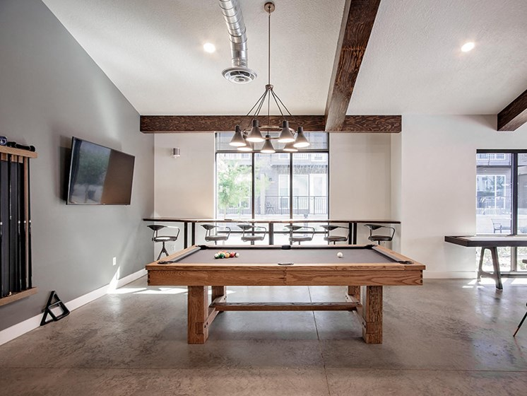 Clubhouse pool table, bar seating and wall tv