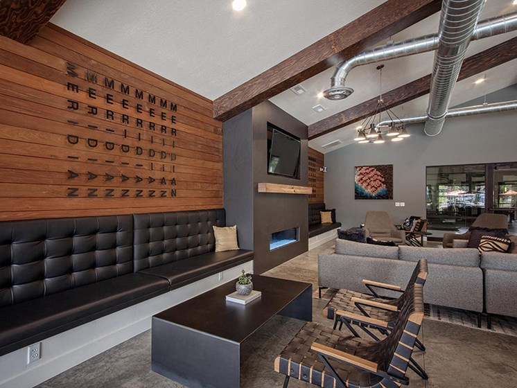 Clubhouse lounge seating, fireplace and wall tv close up
